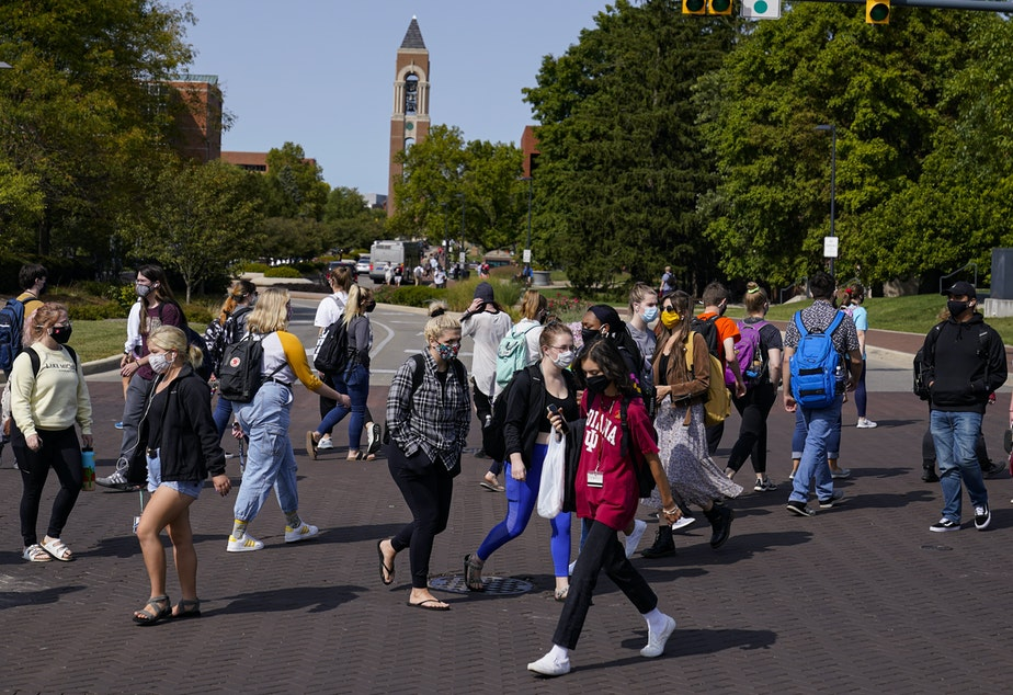 caption: As students return to college campuses, the surrounding communities are seeing an increase in coronavirus infections