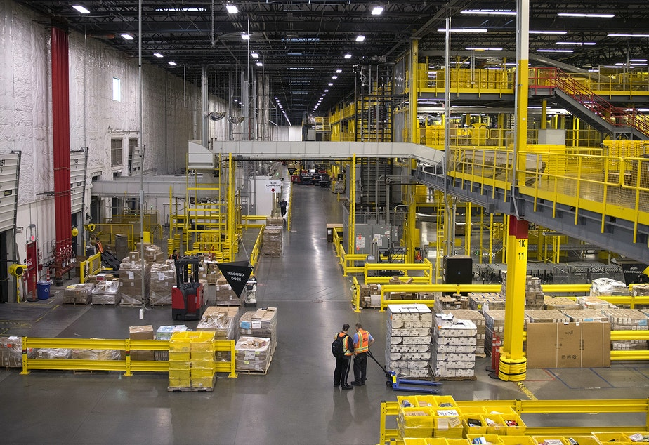 caption: The interior of an Amazon fulfillment center is shown on Friday, November 3, 2017, in Kent.