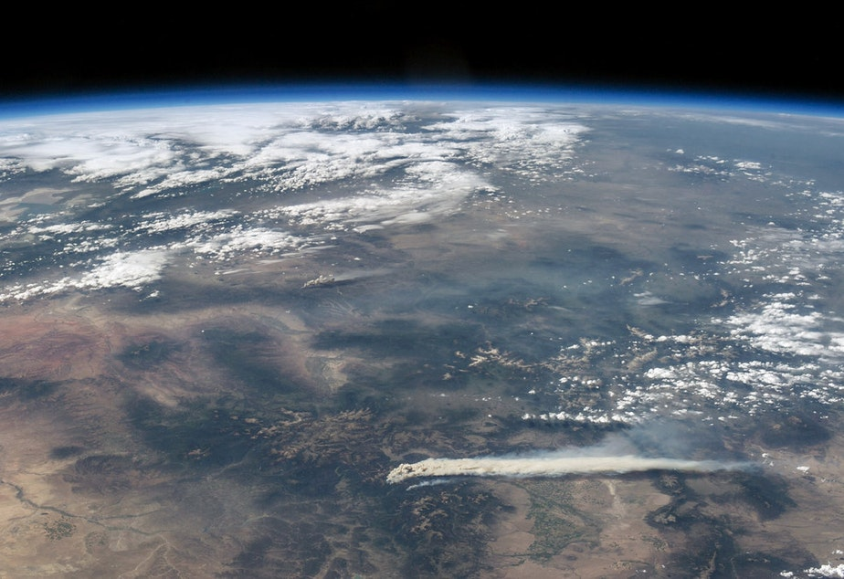 caption: Thick plumes of smoke billow across the landscape from the West Fork Complex fire, burning in southwestern Colorado near Pagosa Springs in June 2013. This photo was taken by astronauts aboard the International Space Station during Expedition 36.
