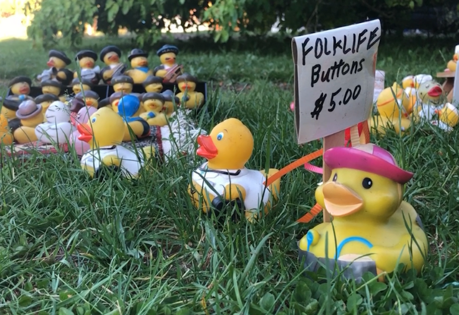 caption: The McFerrins in Seattle's Wedgwood neighborhood have been making rubber duck displays in their front yard since about 2011. The displays change with the seasons. This spring/summer display features the Folklife Festival.