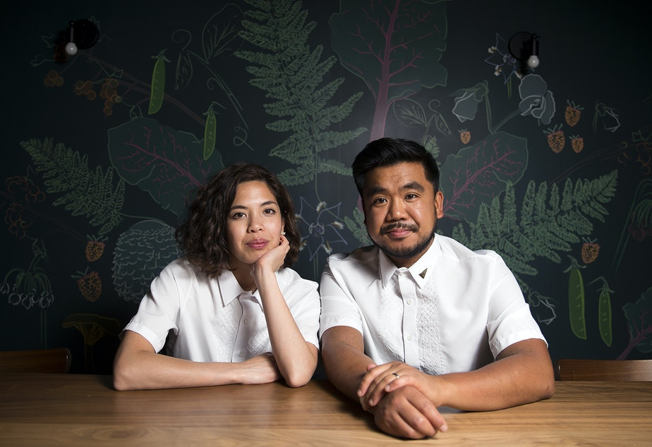 Amber Manuguid and Aaron Verzosa pose for a portrait at their South Seattle restaurant Archipelago.
