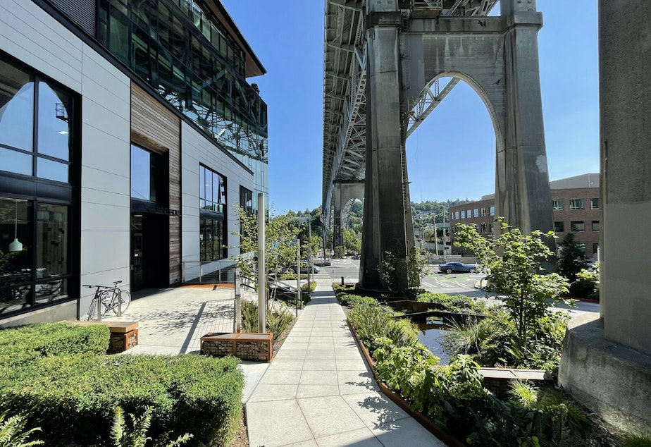 """caption: """"Watershed"""" is the name of the building Weber Thompson designed and now occupies in Fremont. In this photo, it's visible on the left, under the Aurora Bridge."""