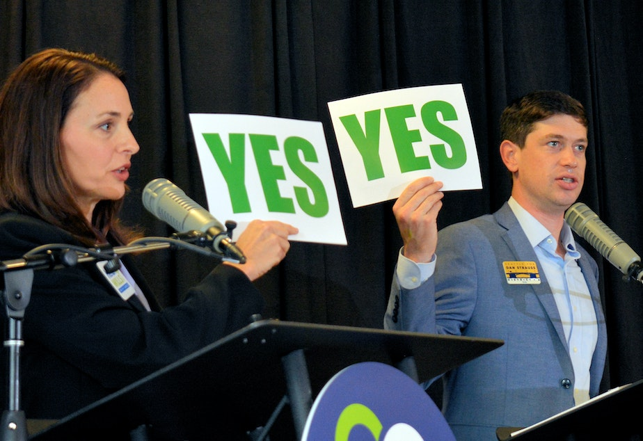 caption: Heidi Wills and Dan Strauss hold agree on a topic during the lightning round of Saturday's CityClub debate for Seattle City Council District 6.