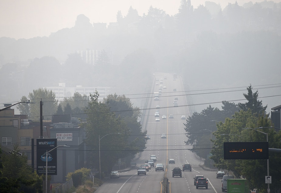 caption: Vehicles travel across the Aurora Bridge as a massive plume of smoke from wildfires burning in California and Oregon makes it's way into the area, on Friday, September 11, 2020, in Seattle.