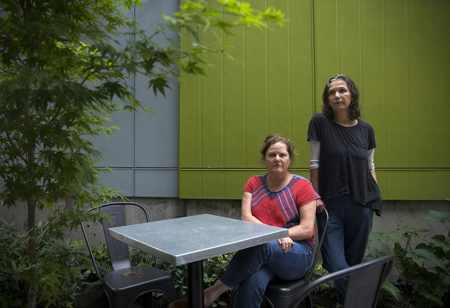 caption: Co-owners of Petite Soif, Lauren Feldman, left, and Shawn Mead, right, are portrayed in the patio area of their business on Thursday, July 16, 2020, along Beacon Avenue South in Seattle.