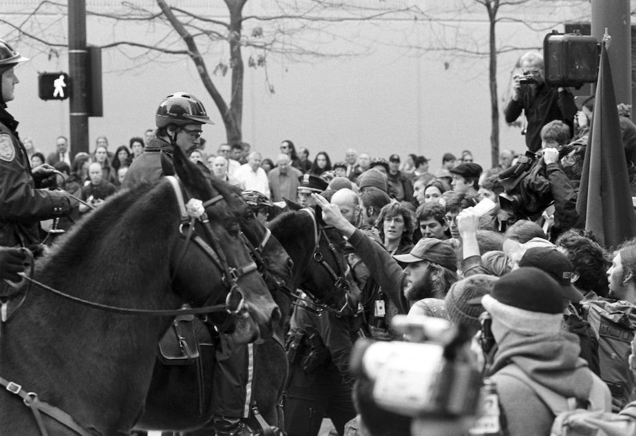 Mounted police with protesters in Seattle Nov. 29, 1999.