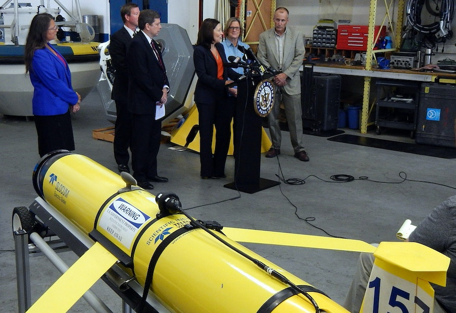 "caption: Sen. Maria Cantwell speaks at a press conference next to a ""wave glider"" of the kind currently being used to monitor ocean acidification in the Gulf of Alaska."