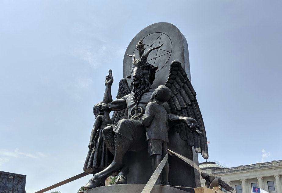 The Satanic Temple's statue of Baphomet, seen at a rally in Little Rock, Ark. The organization says a statue in <em>Chilling Adventures of Sabrina</em> bears too close a likeness to its own work.