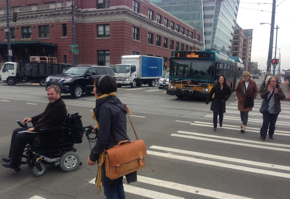 caption: KUOW reporter Ruby de Luna interviews David Whedbee about the challenges of navigating a wheelchair around bad curb cuts in Seattle.