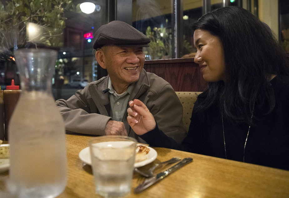 caption: Duc Tan, left, and his daughter, Thanh Tan, laugh while eating at Ramblin Jack's Restaurant on Friday, September 29, 2017, in Olympia. KUOW Photo/Megan Farmer