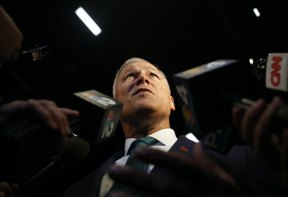 caption: Democratic presidential candidate Washington Gov. Jay Inslee, speaks to the press before the start of the Democratic primary debate hosted by NBC News at the Adrienne Arsht Center for the Performing Art, Wednesday, June 26, 2019, in Miami.