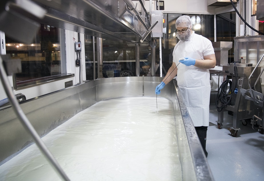 Garrett Barton works at 4:18 A.M. on Monday, June 10, 2019, at Beecher's Cheese in Seattle.