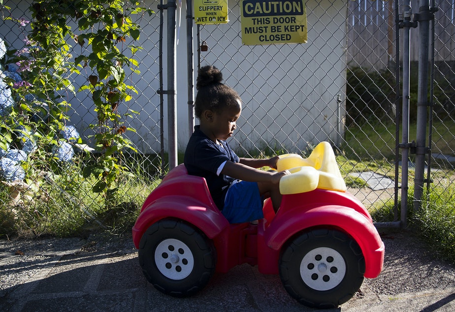 caption: FILE PHOTO: Curtis Brown, 5, plays at an overnight daycare facility on Thursday, August 1, 2019, in Renton.