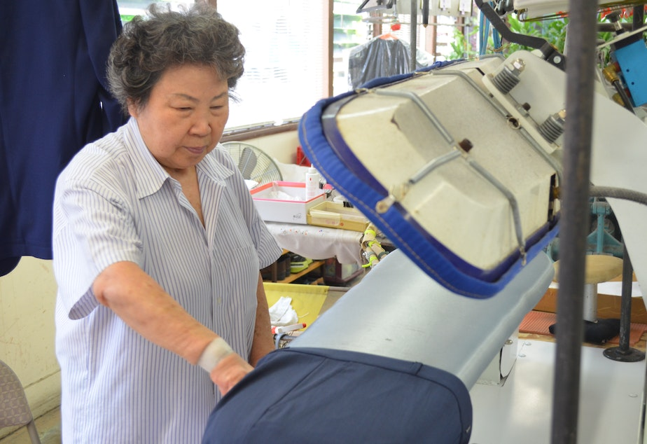 Hyen Sook Kang works in her Wallingford business, Sun Dry Cleaners. She says that since switching to wet cleaning process she's been feeling better.