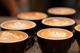 Lattes themselves will not be taxed under the sweetened beverage distribution tax. However, the syrups going into them will be.