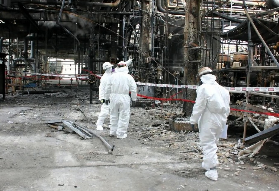 caption: Chemical Safety Board investigators inspect wreckage at the Tesoro-Anacortes refinery in 2010.
