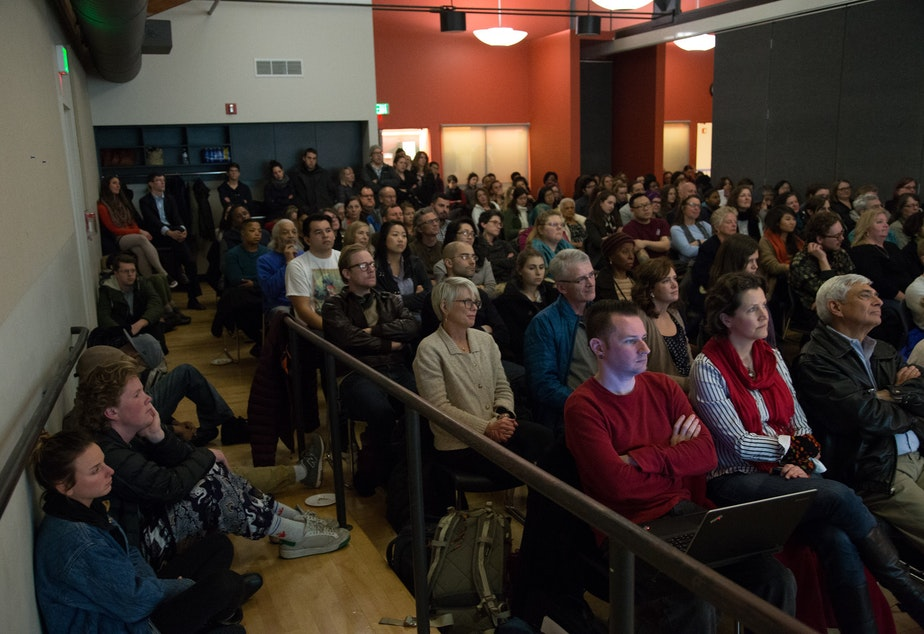 caption: Audience members at the 'StoryCorps' listening party in New Holly on Feb 4., 2016.