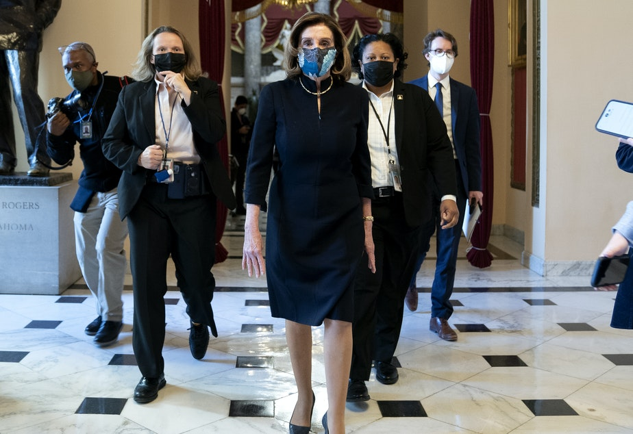 "caption: House Speaker Nancy Pelosi, D-Calif., said that impeaching President Trump is ""a constitutional remedy that will ensure that the republic will be safe from this man."" She's seen here walking to the House floor on Wednesday, ahead of the vote."