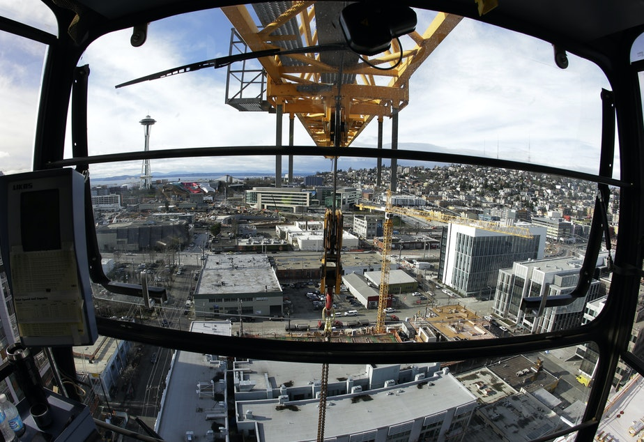 caption: A view of Seattle's future: Income tax and apartment construction?