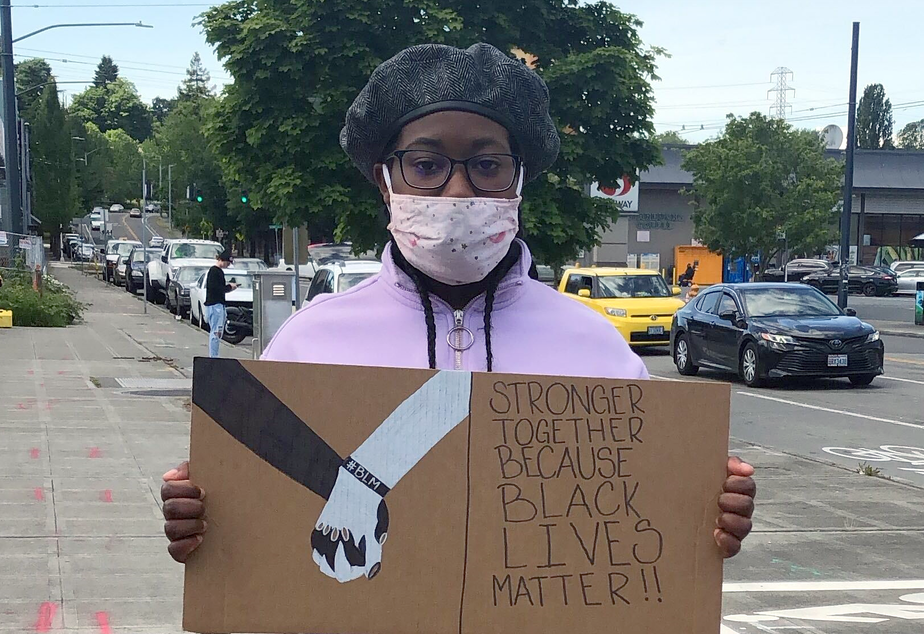 caption: Rainier Beach High School student Angelina Riley protested Seattle School District's relationship with Seattle Police Department on June 5, 2020.