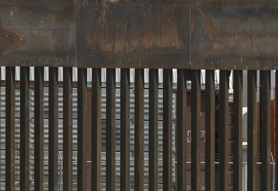 caption: The border wall set back from the geographical border, in El Paso, Texas. The White House said Thursday that an appeals court ruling has cleared the way for border wall construction to resume.