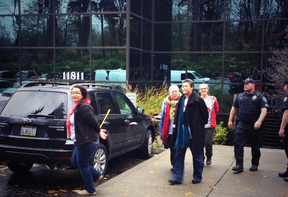Peggy Lynch, in the blue scarf, wife of Seattle Mayor Mike McGinn, was arrested on Thursday for being part of a sit-in at the state's Republican Party headquarters.