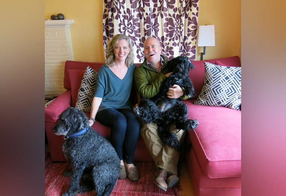 caption: Kristin Rowe-Finkbeiner, Bill Finkbeiner and the dogs they argue about.