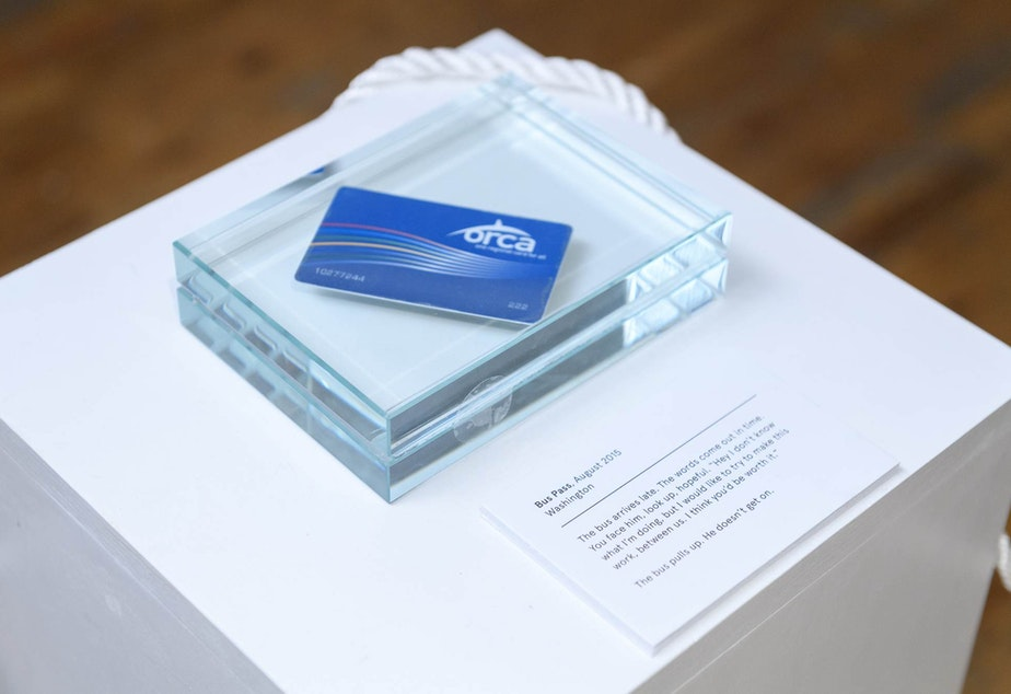 caption: An Orca card encased in glass tells the story of a reality that almost was.