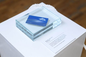 An Orca card encased in glass tells the story of a reality that almost was.