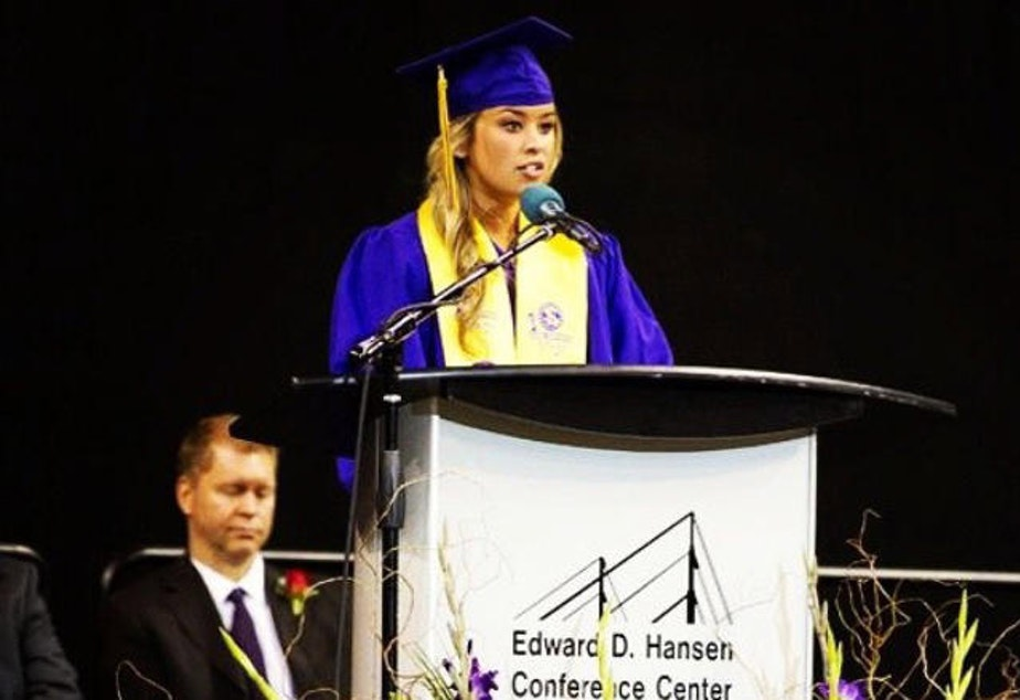 caption: Ivy Jacobsen speaking about her abuse at her high school graduation.