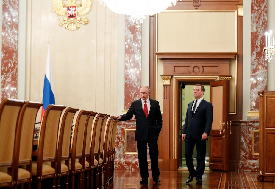 Russian President Vladimir Putin and Prime Minister Dmitry Medvedev speak before a meeting with members of the government Wednesday in Moscow. The cabinet members resigned after Putin proposed a series of constitutional reforms, according to Russian news agencies.