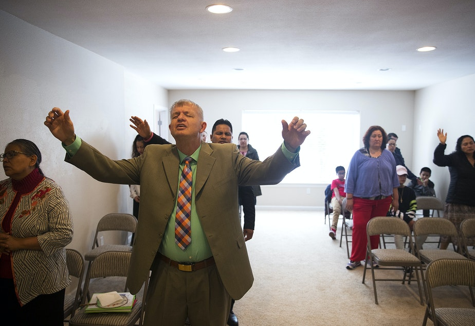 Nathan Roberts, center, during a church service in the basement of his home on Sunday, September 16, 2018, in Des Moines.