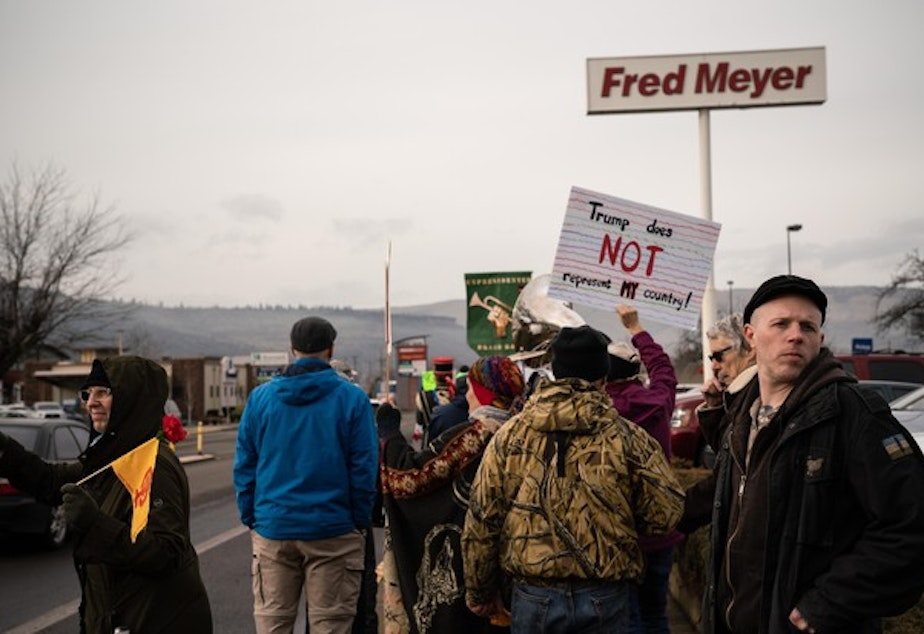 <p>Ross Eliot, a leftist activist and proponent for armed self-defense, looks behind the Women's March for any possible threats on Jan. 19, 2019 in Hood River, Ore.</p>