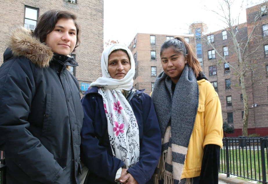 caption: Queensbridge Houses tenant Nayrin Muhith (center), with affordable housing advocates Lena Afridi (left) and Sabrina Jalal (right).