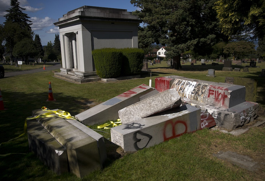 caption: A monument for Confederate soldiers is shown toppled on Sunday, July 12, 2020, at Lake View Cemetery in Seattle. The memorial, erected in 1926, was built by the United Daughters of the Confederacy.