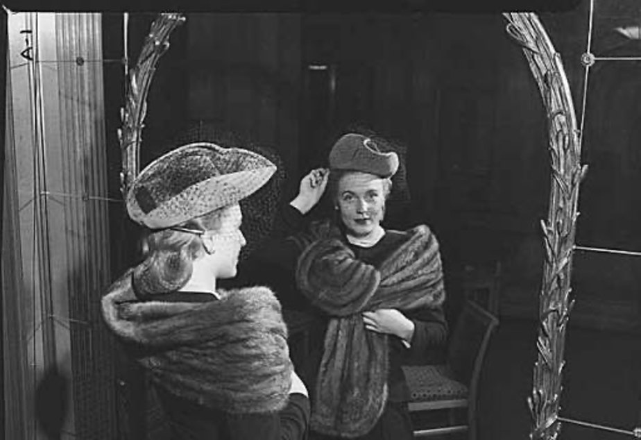caption: A woman models a hat and stole at I. Magnin in Seattle (1947). Fur may be taboo in the Northwest, but the industry is still booming.
