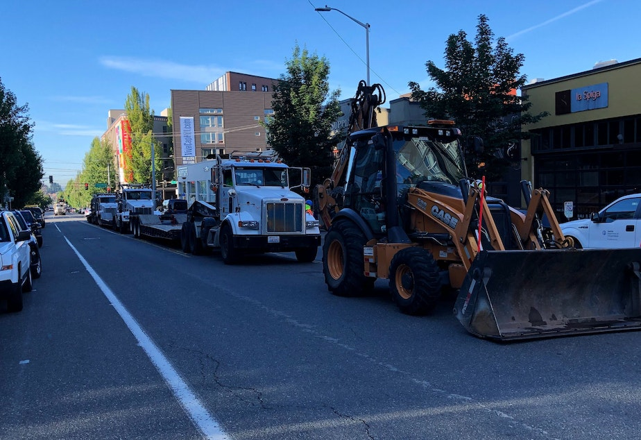 caption: The city of Seattle staged vehicles outside the CHOP Friday morning before an attempt to remove road barriers.