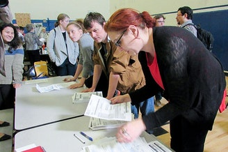 Precinct volunteers count caucus votes at Martin Luther King Jr. Elementary School in Seattle on Saturday, March 26. Democrats turned out across the state to support Bernie Sanders or Hillary Clinton.