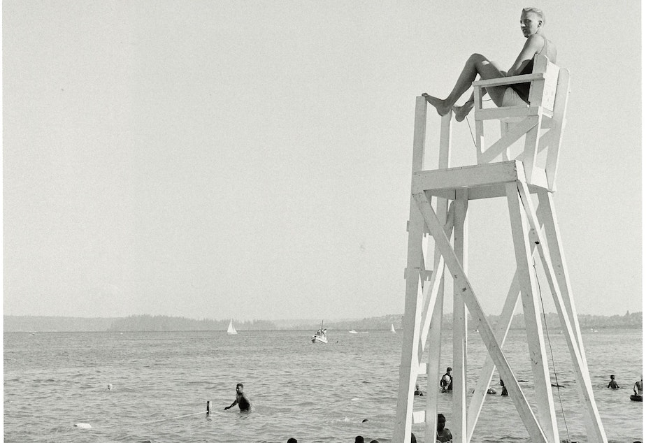 Sonny Norris was Seattle's first black lifeguard, pictured here at Madrona Beach in 1955. Madrona Beach was considered Seattle's black beach for swimming and picnics, per MOHAI's book on Al Smith, 'Seattle on the Spot.'