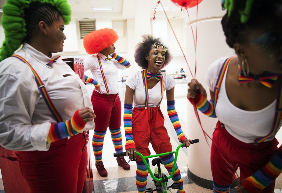 Sarabia Freeman Edwards, second from right, laughs while waiting backstage with Mr. Naturalz Salon team members during the 7th annual Reign of Style Hair Show and Competition on Sunday, March 3, 2019, at the Seattle Center Exhibition Hall on Mercer Street in Seattle.