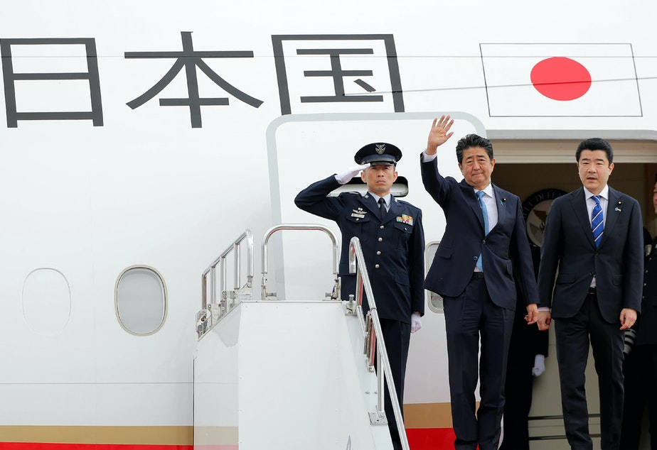 caption: Japan's Prime Minister Shinzo Abe waves to well-wishers on his departure from Tokyo's Haneda Airport on Wednesday for a two-day visit to Iran.