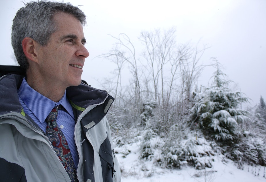 Snoqualmie Mayor Matt Larson stands in front of the property he wanted opened up to development.
