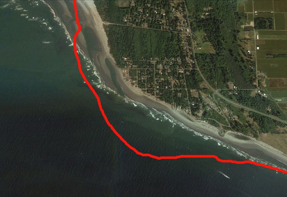 caption: Satellite view of Washaway Beach in 2011. The red line marks the shoreline in 1990.