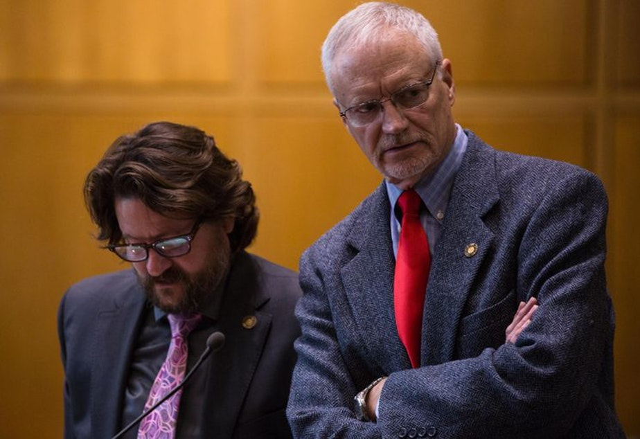 caption: Former House Minority Leader Carl Wilson, right, says fractured relationships in Salem are a key reason for current dysfunction.