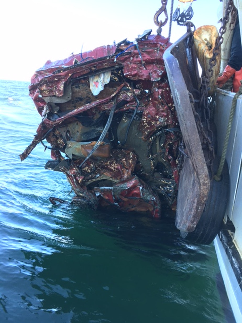 The scrap car Larry Buzzell and crew discovered in their fishing net in 2016, miles off the Olympic coast.