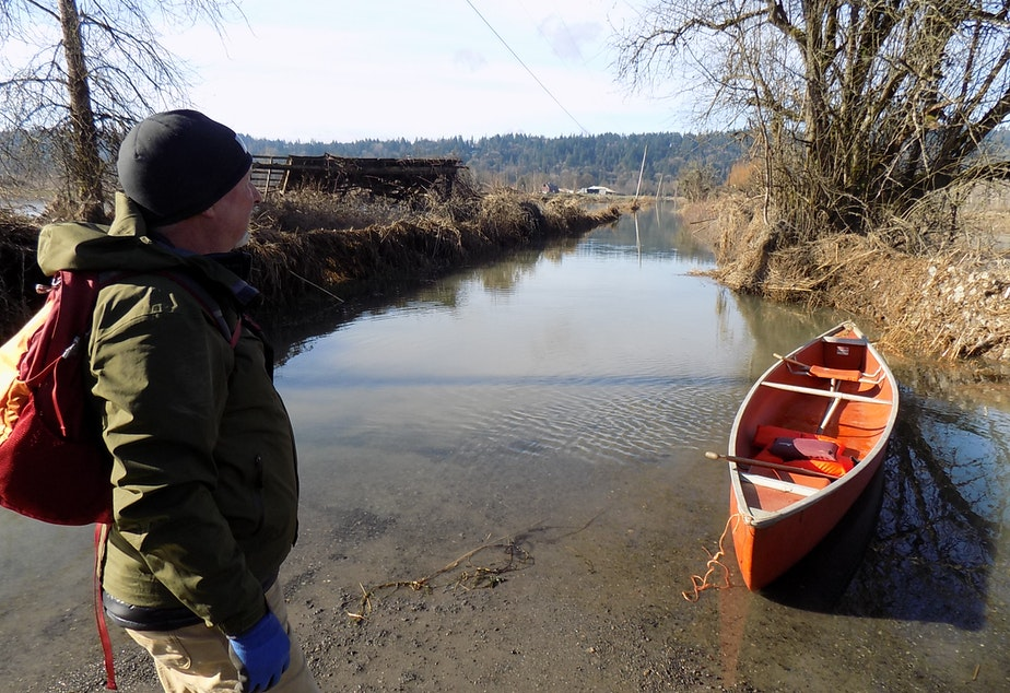 caption: Jim Haack gets ready to go to work. What appears to be a canal is actually Northeast 138th Street south of Duvall, Washington.