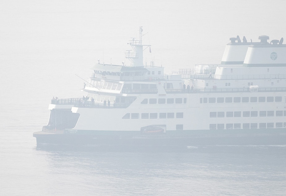caption: A ferry arrives in downtown Seattle as heavy smoke from wildfires burning in Oregon and California clouds the air on on Friday, September 11, 2020, in Seattle.