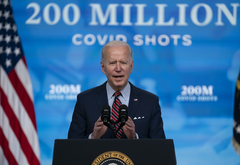 caption: When President Biden arrives to give his speech to a joint session of Congress on Wednesday night, he will be masked as he enters what will be a noticeably less crowded, more socially distanced House chamber. Here, Biden speaks about COVID-19 vaccinations at the White House.