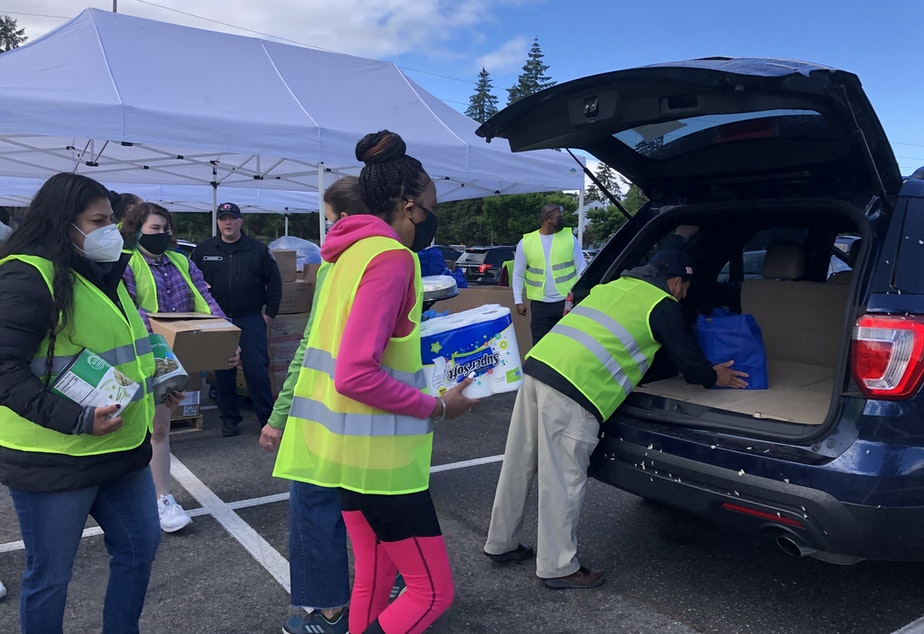 caption: More than 600 military families came to this food distribution event in Lakewood, Tacoma.