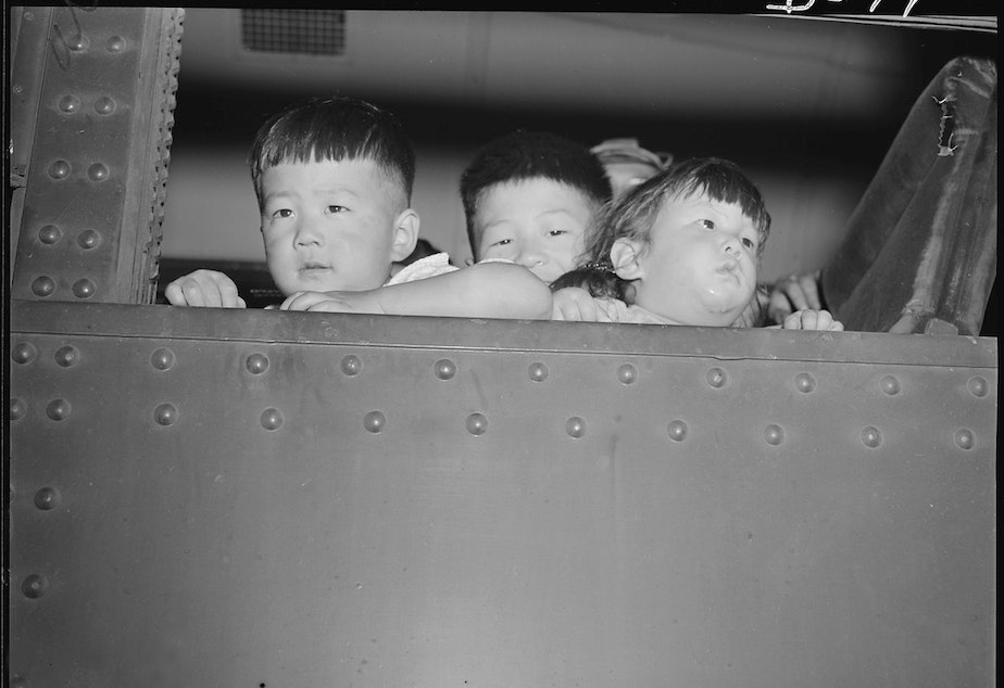 Eden, Idaho. Gerald, 5, David, 6 and Chester Sakura, Jr., 1 1/2 brothers. These little evacuees, along with 600 others from the Puyallup assembly center, have just arrived here and will spend the duration at the Minidoka War Relocation Authority center.